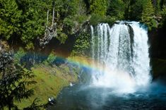 These amazing waterfalls splash into the water, creating mist that often catches rays of sunlight to form picturesque rainbows.