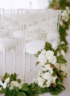 Gorgeous wedding aisle garland made with mixed greenery and white flowers. #wedding #decor #floral