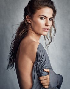 Flaunting her back, Cameron Russell wears Rick Owens dress and Maria Black earring