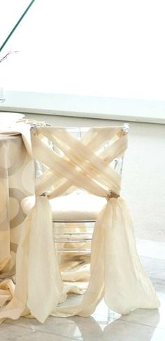 That extra touch! #WeddingDecor #ChairDecor | SocialTables.com | Event Planning Software Wedding Chair Covers, Party Chair Covers, Chair Decorations For Wedding, Chairs For Wedding, Chivari Chairs Wedding, Wedding Chair Sashes, Chair Back Covers, Tulle Decorations, Chair Covers For Weddings