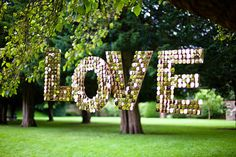 """We love this """"Love"""" sign! Sparkling in a bold font, this wedding reception decor piece is a unique nod to typography."""