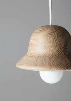 Norm Architects have designed HAT for EX.T, a pendant lamp made from wood, that was inspired by the hat blocks milliners use to make hats.For the Hat lamp, Norm Architects took their inspirati Lamp Design, Lighting Design, Pendant Lamp, Pendant Lighting, Chandelier, Supreme Furniture, Minimal Bathroom, Interior Desing, Cool Lamps