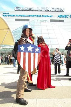 A female Comic fan in an original Captain America costume poses for photos as thousands attend the MCM London Comic Con at Excel Centre