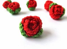 Crocheted roses applique with green leaves