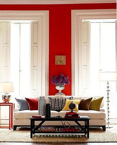 Red Rooms: Decorating With the Color Red - Living room with red walls, white molding, white couch