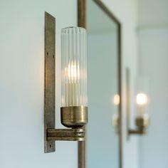 Raydon Wall Light in Antiqued Brass (Fluted Glass) Bathroom Sconces, Bathroom Wall Lights, Glass Bathroom, Bathroom Lighting, Brass Wall Lights, Light Bathroom, Master Bathrooms, Bathroom Inspo, Factory Lighting
