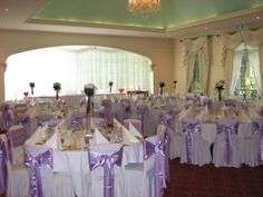 purple satin chair sash with flower centres