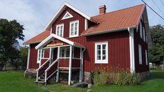 Länsmansgården. Typical swedish houses with well-kept style, Kalvsvik, Sweden