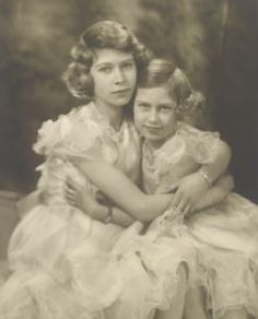 Princesses Elizabeth and Margaret--1939--Right before the outbreak of World War II. The last pictures of the princesses wearing frilly dresses and lovely necklaces.