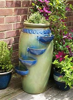 Dempsy Earthenware 4 Tier Cascade Water Feature and Planter.