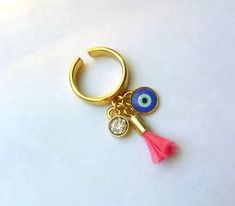 Anel Reveillon Ano Novo com amuleto Olho grego