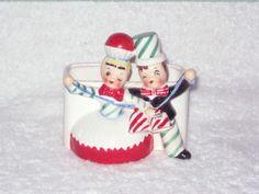 Vintage Christmas Hard to Find Shopper Girl and Man CUPCAKE Planter Figurine porcelain ceramic Japan Napco Lefton Holt Howard era Candy cane. $95.00, via Etsy.