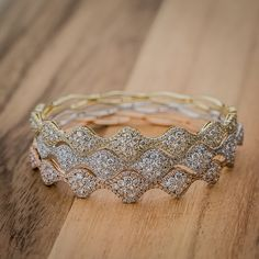 We couldn't pick just one either. White Gold, Rose Gold and White Gold Diamond Cluster Bangles