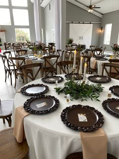 Our embossed chargers and tan napkins were perfect in this venue! Check out all the different styles and colors we have online or stop in the showroom! www.a1wedding.com 903-463-7709