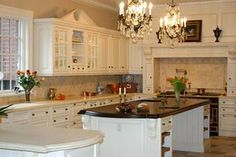 Antique cream island with different color countertop