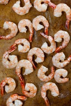 How To Roast Shrimp in the Oven   Kitchn Seafood Dishes, Fish And Seafood, Seafood Recipes, Frozen Shrimp Recipes, Shellfish Recipes, Shrimp In The Oven, How To Cook Shrimp, Bake Shrimp In Oven, Oven Cooked Shrimp