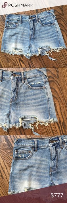 """Free People distressed denim shorts sz 24 Free People distressed denim shorts, five pocket styling, medium wash, whispering, button zip fly, soft cotton, a summer staple. Approx 13 1/4"""" waist, 3"""" inseam when laid flat, size 24 (L5) offers warmly received. Free People Shorts"""