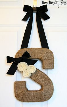 Jute twine wrapped monogram wreath. Can be found on etsy.com