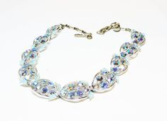 Pre Holiday Sale !!! Rhinestone & Blue Leaf Necklace - #Vintage Mid Century Aurora Borealis Crystal Rhinestones - 1950's era #Jewelry offered by TheJewelSeeker  This is a bea... #teamlove #vintage #jewelry #iridescent #thejewelseeker