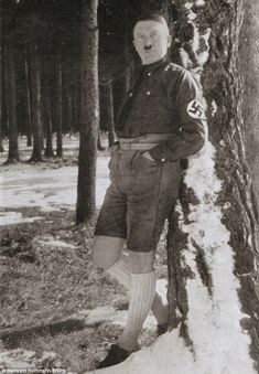 "Hitler wearing lederhosen whilst striking an ""absurdly camp pose"".   Photograph by Heinrich Hoffmann."
