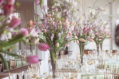 Love these super tall vases with long stem tulips and cherry tree blossoms as centerpieces... It's the perfect blend of rustic and romantic for wedding decor!  From a romantic wedding at the Chatham Bars Inn on Cape Cod, MA!