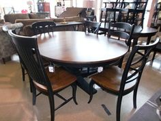 Shop for Clearance 8PC DINING ROOM, BNTAB054011963ATPD-6, and other Tables at Walter E. Smithe in 10 Chicagoland locations in Illinois and Merrillville, Indiana. CLEARANCE ITEM  8 piece dining set includes 6 chairs and table with base in a two tone finish. Table is round with one leaf.