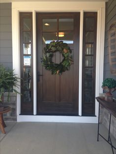Front Door On The Farmhouse With Magnolia Wreath