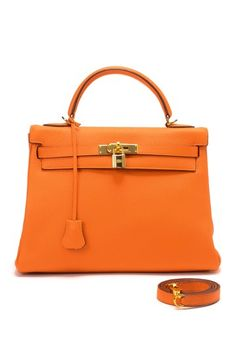 Vintage Hermes Leather Kelly $2 ,400. wondering what its like to walk in a store and buy such a luxury item? Hmmm rather spend it on a trip!