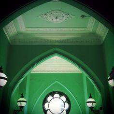 Green paint, white plaster