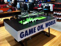 Nike retail table display sports shoe display.
