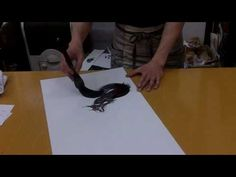 Amazing artist paints a dragon using a Japanese Sumie technique.  Here is the full version.