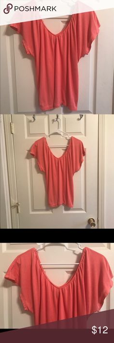 American Eagle, Relaxed V-Neck Top, Size...XS Gorgeous coral colored top in excellent condition. It reminds me of spring and summer. It's 50% polyester and 50% viscous. American Eagle Outfitters Tops Blouses