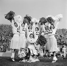 University of Maryland cheerleaders at football game, circa 1950