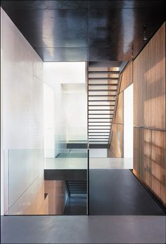 steel stair, timber screen, black + white