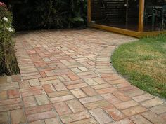 Basket weave brick paving leading to deck