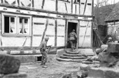 After crossing the Franco-German border, men from the 45th Division go on a house-to-house search in Bobenthal, Germany. December 1944