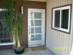 A gorgeous aluminum glass door from ETO Doors that sets up a beautiful decor for the exterior of the house