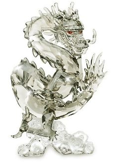 Swarovski Crystal Zodiac Dragon in clear crystal. The dragon is believed in ancient China to have been the reincarnation of the Emperor thus considered very majestic and powerf Dragon Figurines, Glass Figurines, Swarovski Crystal Figurines, Swarovski Crystals, Dragons, Crystal Kingdom, Crystal Dragon, Year Of The Dragon, Crystal Collection