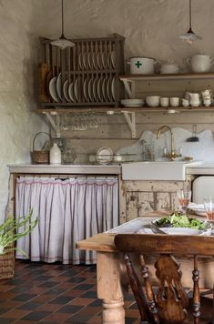how cute is this rustic country farmhouse kitchen with open shelves, terracotta tile floor, linen cupboard curtain, wooden plate rack, farmhouse table and reclaimed wooden units? Click through for more modern rustic farmhouse interiors ideas you'll love Modern Rustic Decor, Rustic Kitchen Design, Vintage Kitchen, Rustic Country Decor, Rustic Cottage, Rustic Design, French Rustic Decor, Antique Kitchen Decor, Rustic French Country