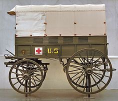 Ambulance 1898: Purchased by the Central Cuban Relief Committee of New York for use by Clara Barton and the American National Red Cross, it was sent to Camp Thomas, an army debarkation camp in Chickamauga, Georgia.  The Red Cross nurses at Camp Thomas helped care for U.S. Army soldiers called to Cuba, many of whom suffered that summer from typhoid. After the war, this ambulance was used at the Red Cross HQ in Glen Echo, MD, a distribution center for relief supplies.