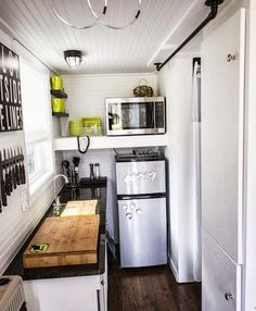 Nice. I want this next size up fridge with freezer instead of the tiny dorm room size. it certainly puts a microwave at the right height. I would put a large cabinet door next to the fridge and MW.