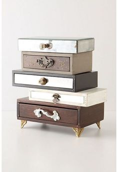 This stack of small drawers is a chic way of hiding your jewelry, or even a nail file or lip balm next to your bed.