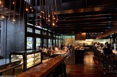 The interior – contemporary style with dark timber flooring and exposed ceiling beams, stone and stainless steel bar counter