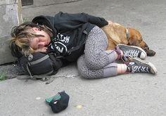 sleeping female crusty punk and her dog