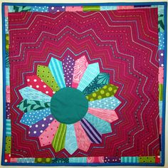 Another fun Dresden Plate -- I the bold, happy fabric choices!