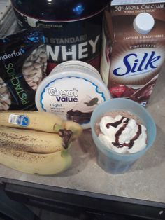 Healthy Protein Shake! 8oz chocolate soy milk, 1/2 of banana, 1 scoop of protein powder, 15 pistachios, and light cool whip