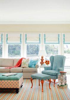 Blue & Orange Living Room.  I like the shades.