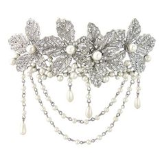Heirloom Leaves Hair Clip£88.00 (0 reviews)    Read reviews   |   Write a review A heirloom headpiece to treasure and hand down to feature generations, our Heirloom Leaves Hair Clip is exquisite. Featuring four Austrian crystal studded leaves enhanced with scalloped ivory pearl garlands and droplets, you would be forgiven for mistaking this beautiful 'piece' for a precious family treasure