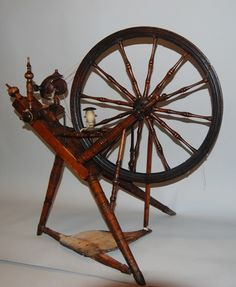 Norwegian spinning wheel.  While this photo is from museum in Norway, there has been a cluster of wheels found in Black Earth WI and photos supporting their use in 1800s