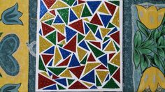 I made this mosaic tile with colorful glitter sheets! Well it's actually cardboard and i cut triangles out of these sheets and stick them in mosaic pattern! It's good for hanging on the wall